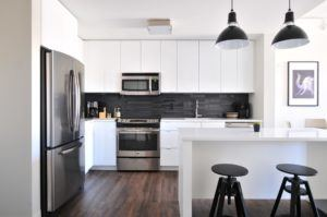 Clean white kitchen with stainless steel appliances