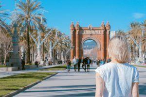 Woman walking through European park